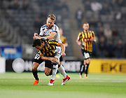 STOCKHOLM, SWEDEN - MARCH 12: Daleho Irandust of BK Hacken and Jacob Une Larsson of Djurgardens IF competes for the ball during the Swedish Cup Quarterfinal between Djurgardens IF and BK Hacken at Tele2 Arena on March 12, 2018 in Stockholm, Sweden. Photo by Nils Petter Nilsson/Ombrello<br /> ***BETALBILD***