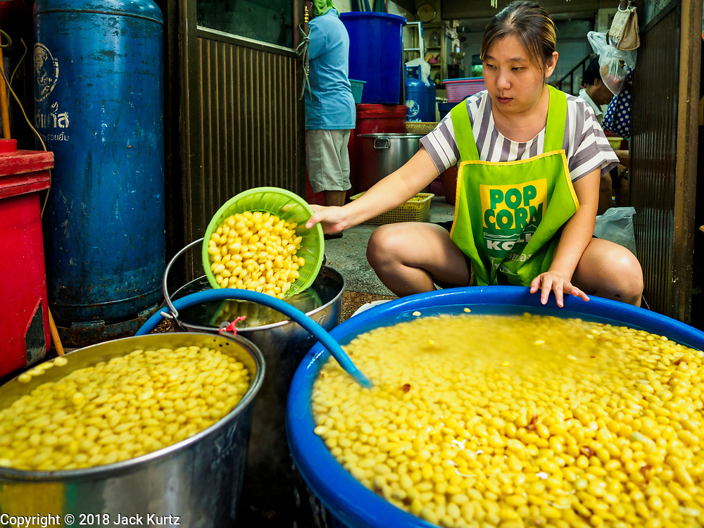 "07 FEBRUARY 2018 - BANGKOK, THAILAND: A woman in Bangkok's ""Chinatown""  sorts boiled mung beans for desserts consumed during Lunar New Year celebrations. The Lunar New Year, also called Tet or Chinese New Year, is 16 February this year. The coming year will be the Year of the Dog. Thailand has a large Chinese community and Lunar New Year is widely celebrated in Thailand, especially in Bangkok and large cities with significant Chinese communities.      PHOTO BY JACK KURTZ"