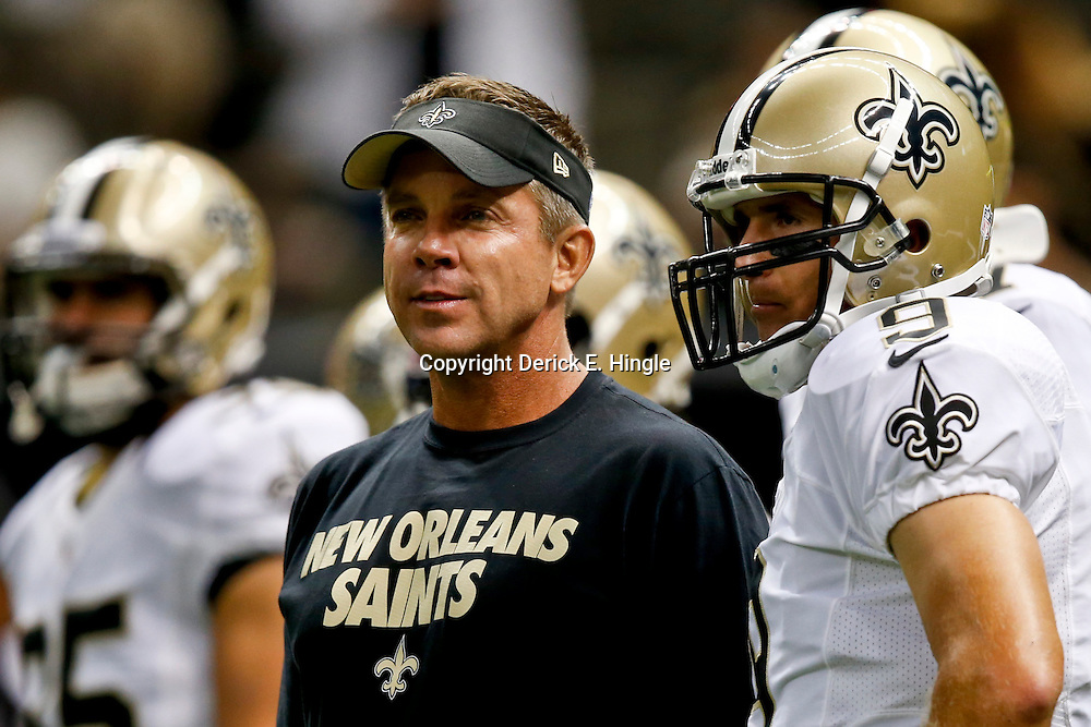 Aug 9, 2013; New Orleans, LA, USA; New Orleans Saints head coach Sean Payton talks with quarterback Drew Brees (9) before a preseason  game against the Kansas City Chiefs at the Mercedes-Benz Superdome. Mandatory Credit: Derick E. Hingle-USA TODAY Sports