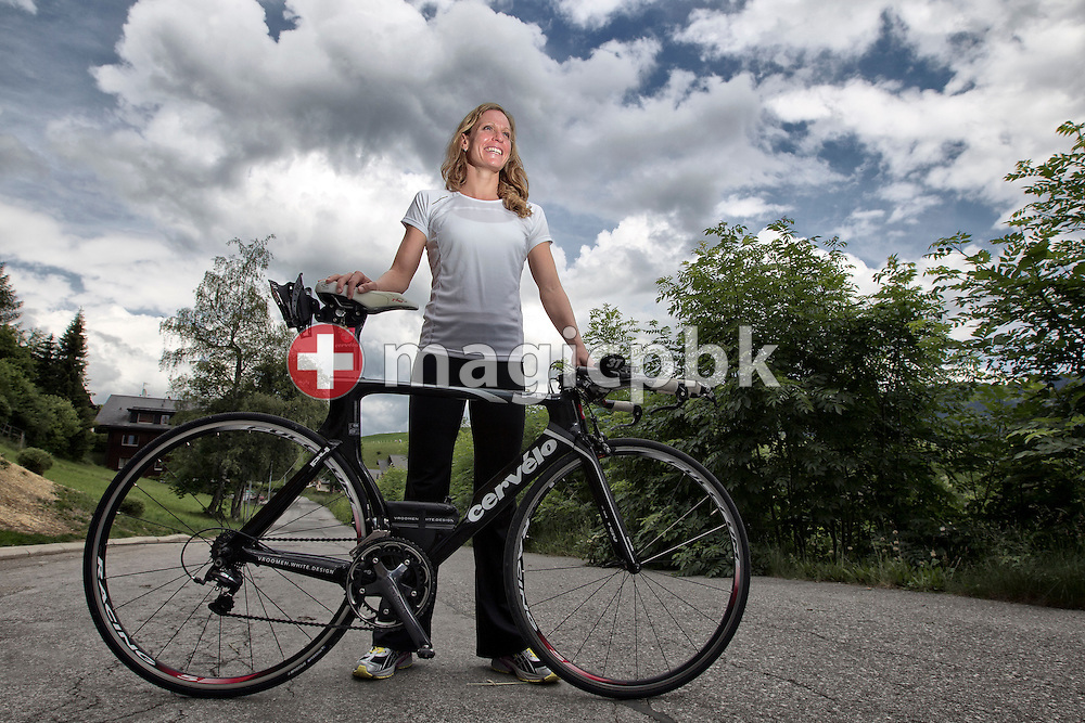 Triathlete Caroline STEFFEN of Switzerland poses with her racing bicycle (road bike) during a photo session in Leysin, Switzerland, Wednesday, June 15, 2011. (Photo by Patrick B. Kraemer / MAGICPBK)