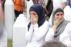 60113383  <br /> People mourn for their relatives killed during the Sreberenica Massacre in Srebrenica, Bosnia and Herzegovina, July 11, 2013. Thousands of in Bosnia and Herzegovina gathered on Thursday at Potocari Memorial Centre near Srebrenica to mourn for victims in the 1995 Srebrenica Massacre. A total of 409 newly-identified victims were buried at the centre on the 18th anniversary of the massacre, putting the numbers of gravestones to over 6000, picture taken Thursday, July 11, 2013.<br /> Photo by imago / i-Images<br /> UK ONLY