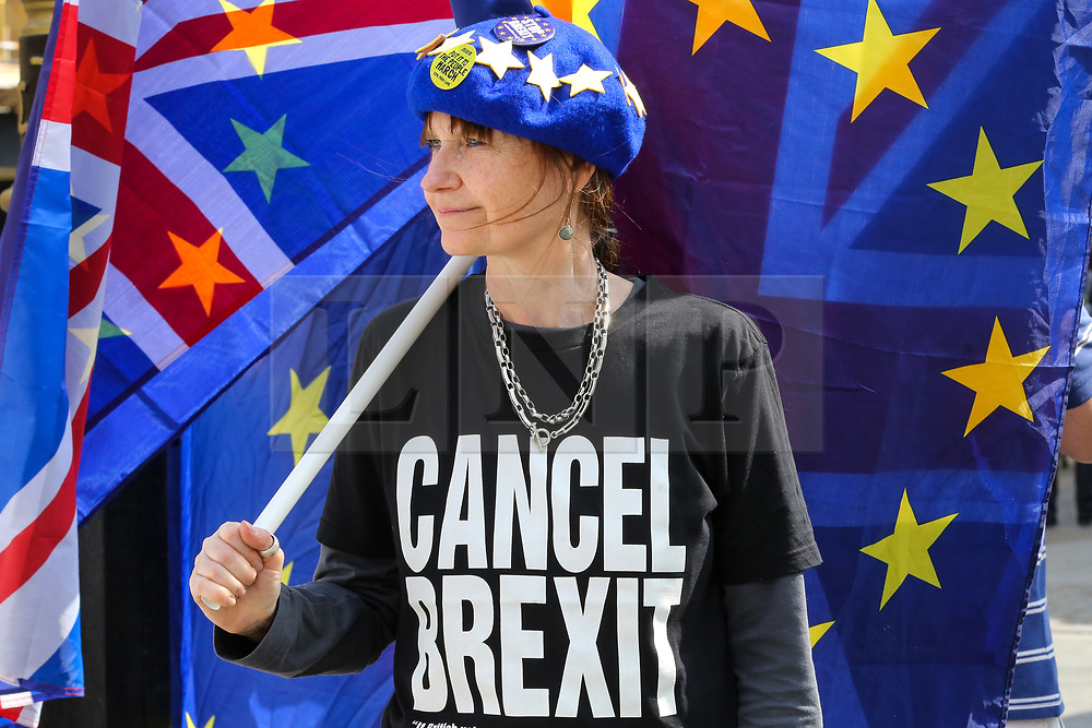 "© Licensed to London News Pictures. 30/04/2019. London, UK. An anti-Brexit demonstrator wearing an EU flag cap and a ""Cancel Brexit"" t-shirt protesting outside the Houses of Parliament. Photo credit: Dinendra Haria/LNP"