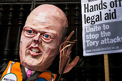 London, June 16th 2014. Lawyers, students and barristers demand that Justice Minister Chris Grayling keep his hands off legal aid as they protest outside the Old Bailey against cuts to legal aid budgets.
