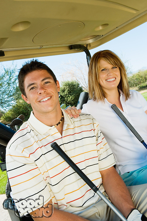 Golfing Couple Sitting in Golf Cart