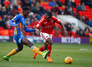Charlton Athletic's Sullay Kaikai and Shrewsbury Town's Aristote Nsiala during the EFL Sky Bet League 1 match between Charlton Athletic and Shrewsbury Town at The Valley, London, England on 24 February 2018. Picture by John Marsh.