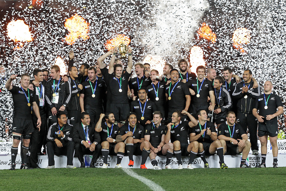 New Zealand's captain Richie McCaw holds the cup and celebrates with team mates after defeating France in the Rugby World Cup final at Eden Park, Auckland, New Zealand, Sunday, October 23, 2011.  Credit:SNPA / David Rowland