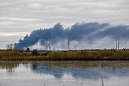 Plume  seen from Bridge City Texas, ( ten miles away)  from a massive explosion at  Texas Petroleum Chemical (TPC) plant  in Port Neches Texas, the day after a few exsplosions rocked the plant.