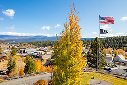 """Downtown Truckee 70"" - Autumn photograph of an American Flag above historic Downtown Truckee, California."