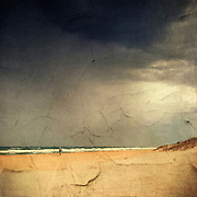 Man walking on beach<br />