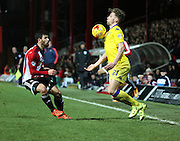 Leeds United defender Charlie Taylor trying to create something during the Sky Bet Championship match between Brentford and Leeds United at Griffin Park, London, England on 26 January 2016. Photo by Matthew Redman.