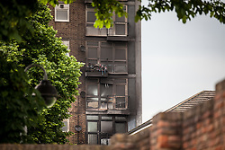 © Licensed to London News Pictures. 11/06/2016. London, UK. The blackened exterior of a tower block on Canterbury Crescent in Brixton, south London, after a large fire broke out on one of the lower floors. Plumes of smoke could be seen from across south London, and some on Twitter also reported hearing an explosion. Photo credit: Rob Pinney/LNP