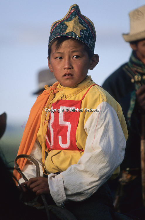 Mongolia. Kid's horse race; naadam of Oulan Bator ; Kid's horse race; naadam of Oulan Bator ; young riders, Naadam horse race