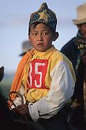 Mongolia. Kid's horse race; naadam of Oulan Bator ; Kid's horse race; naadam of Oulan Bator ; young riders, Naadam horse race