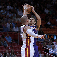17 November 2010: Phoenix Suns' point guard #13 Steve Nash takes a jump shot over Miami Heat's point guard #8 Carlos Arroyo during the Miami Heat 123-96 victory over the Phoenix Suns at the AmericanAirlines Arena, Miami, Florida, USA.