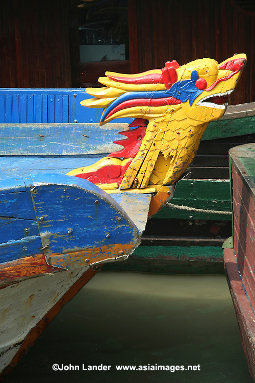 """Halong Bay boat decorated with a dragon for good luck - as the original name for the place is """"Bay of the Descending Dragon"""".  The vast array of boats on Halong Bay, from backpacker budget to mint-on-the-pillow deluxe are available with a huge variety of activities set up for visitors to enjoy:  caving, swimming, kayaking, cooking classes, on deck cocktail parties and more."""