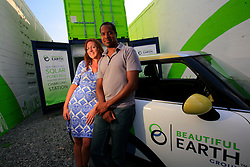 USA NEW YORK 04JUN10 - Amanda Cleary and engineer David Gibbs pose in front of their solar-powered charging station for electric vehicles in Brooklyn, New York. Run by the Beautiful Earth Group, this station is a demonstration site designed to prove that solar power can charge and run electric vehicles. ..jre/Photo by Jiri Rezac..© Jiri Rezac 2010