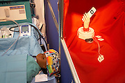 A new hospital equipment concept is demonstrated by an entrepreneur's model at an inventors fair in Alexandra Palace, London