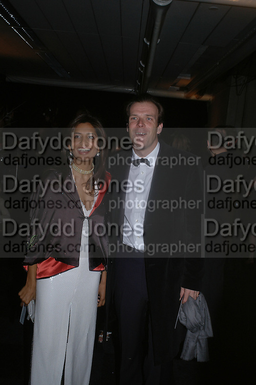 Divia Lalvani and Joel Cadbury, The Black and White Winter Ball. Old Billingsgate. London. 8 February 2006. -DO NOT ARCHIVE-© Copyright Photograph by Dafydd Jones 66 Stockwell Park Rd. London SW9 0DA Tel 020 7733 0108 www.dafjones.com