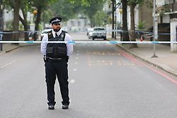 © Licensed to London News Pictures. 31/05/2018. London, UK. The scene at Finborough Road near Cathcart Road, Kensington, where a man believed to be in his 40s was found with multiple stab wounds. The man died at the scene and a murder investigation has been launched. Photo credit: Rob Pinney/LNP