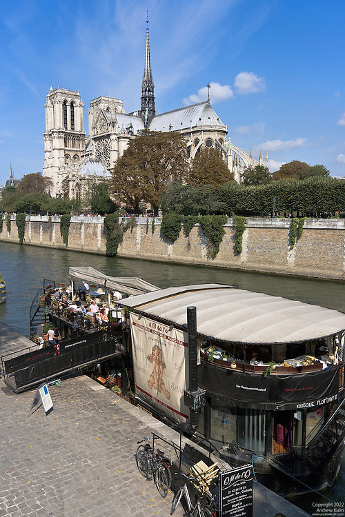 9-shot stitched photograph of the Notre Dame Cathedral and the Seine River.