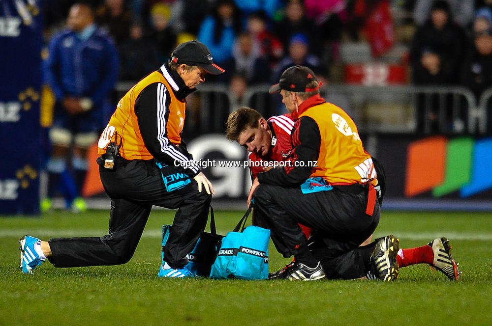 Colin Slade of the Crusaders is checked out by medics in the Super rugby match,  Crusaders v The Blues, at AMI Stadium, Christchurch, on the 5 July 2014 . Photo:John Davidson/www.photosport.co.nz