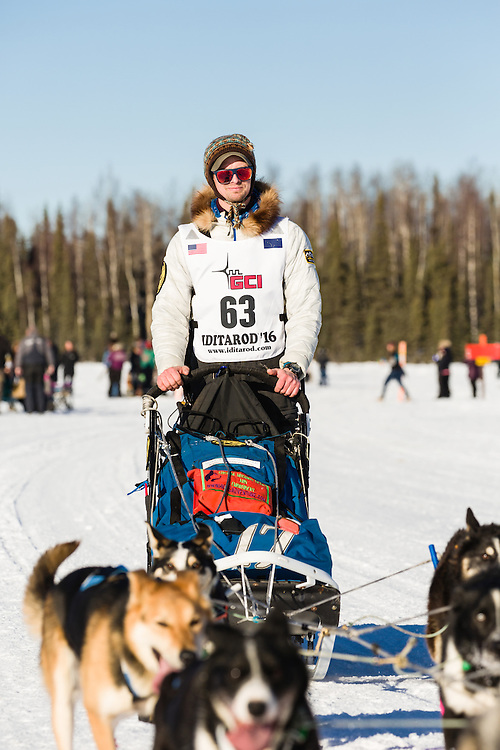 Musher Matt Failor competing in the 44th Iditarod Trail Sled Dog Race on Long Lake after leaving the restart on Willow Lake in Southcentral Alaska.  Afternoon. Winter.