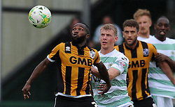 Port Vale's Mark Marshall challenges for the high ball with Yeovil Town's Stephen Kingsley - Photo mandatory by-line: Harry Trump/JMP - Mobile: 07966 386802 - 25/04/15 - SPORT - FOOTBALL - Sky Bet League One - Yeovil Town v Port Vale - Huish Park, Yeovil, England.
