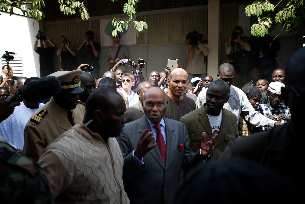 February 26, 2012 - Dakar, Senegal: Senegal's president and candidate, Abdoulaye Wade, leaves the polling station in the Franco-Arab School in Point E area of Dakar. Hundreds of people queueing for voting insulted and heckled Wade, accusing the head of state of disrespect for the country's constitution when running for a third mandate. (Paulo Nunes dos Santos/Polaris)