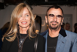"""© under license to London News Pictures. LONDON, 19/05/2011. Barbara Bach with husband Ringo Starr. Opening of the Tommy Nutter Exhibition """"Rebel on the Row"""" at the Fashion and Textile Museum, London. Photo credit should read BETTINA STRENSKE/LNP"""