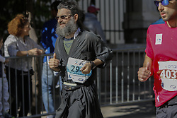 November 13, 2016 - Athens, Attica, Greece - An Orthodox Priest runs in the Athens Marathon. Thousands of people from all over the world took part in the 2016 Athens Marathon the Authentic, which starts in the town of Marathon and is ending in Athens, the route, which according to legend was first run by the Greek messenger Pheidippides in 490 BC. (Credit Image: © Michael Debets/Pacific Press via ZUMA Wire)