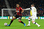 Junior Stanislas (19) of AFC Bournemouth is challenged by Elliot Lee (10) of Luton Town during the The FA Cup match between Bournemouth and Luton Town at the Vitality Stadium, Bournemouth, England on 4 January 2020.