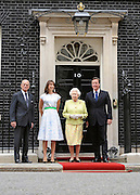 © licensed to London News Pictures. LONDON, UK.  21/06/11. The Queen and Duke of Edinburgh visit Number 10 Downing Street for Lunch with British Prime Minister, David Cameron and his wife Samantha. Visits to the street by the Queen are rare with the last time being in 2002 when Tony Blair was Prime Minister.. Mandatory Credit Stephen Simpson/LNP
