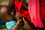 Isatu Kanu, 18, breastfeeds 4 month old Amadu Kargbo, at the therapeutic feeding center of the Magbenthe hospital in Makeni, Sierra Leone, on Thursday February 26, 2009. This is her second child, the first one died of edema at the age of 14 months. She got pregnant with the first child at the age of 15.