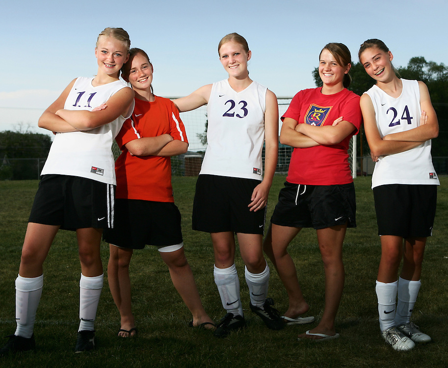 Stephanie Pixton, Lauren Howsden, Jenna Morgan, Becky Deleeuw and Shannon Howsden ? all current or former soccer players for Tooele High School ? celebrate getting back on the field Wednesday after a long recovery. All five of the girls were injured when the car they were traveling in was struck by a drunk driver last January.