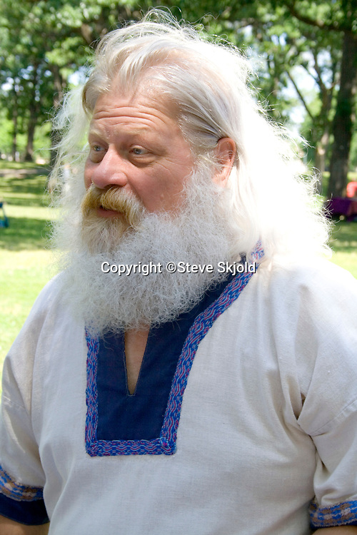 Man with large white beard in costume on Norway Day at Minnehaha Park. Minneapolis Minnesota MN USA