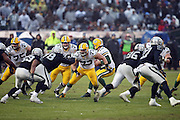 Green Bay Packers tackle JC Tretter (73) blocks in the middle of a group of players during the 2015 week 15 regular season NFL football game against the Oakland Raiders on Sunday, Dec. 20, 2015 in Oakland, Calif. The Packers won the game 30-20. (©Paul Anthony Spinelli)