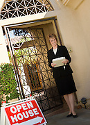 Real Estate Agent at Open House