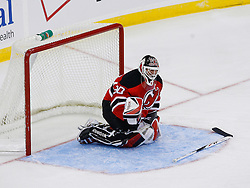 Nov 1, 2008; Newark, NJ, USA; New Jersey Devils goalie Martin Brodeur (30) asks a linesman for time after making a save and injuring his arm during the second period at the Prudential Center. New Jersey Devils goalie Martin Brodeur (30) would leave the game and be replaced by New Jersey Devils goalie Kevin Weekes (1).