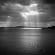 Sunrays burshing through clouds. Hood Canal, Washington