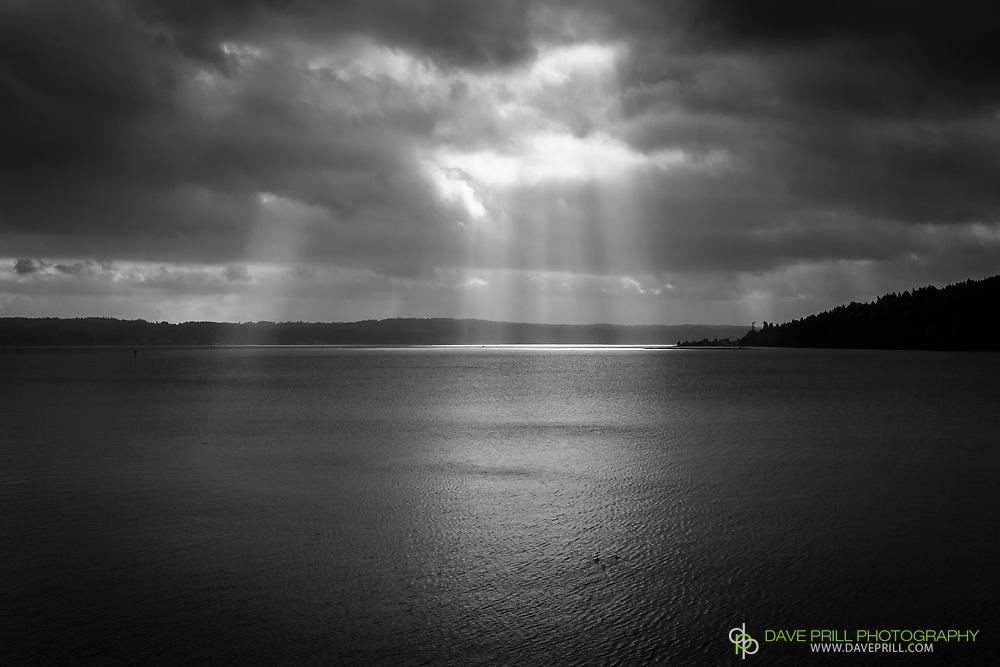 Sunrays burshing through clouds. Hood Canal, Washington