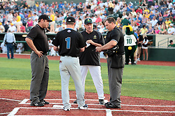 "1 June 2010: Cornbelters manager, Hal Lanier meets at the plate to exchange line up cards. The Windy City Thunderbolts are the opponents for the first home game in the history of the Normal Cornbelters in the new stadium coined the ""Corn Crib"" built on the campus of Heartland Community College in Normal Illinois."