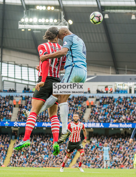 Southampton defender Virgil van Dijk (17) and Manchester City defender Vincent Kompany (4) challenge for a header in the Premier League match between Manchester City and Southampton<br /> <br /> (c) John Baguley | SportPix.org.uk