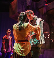 Romeo (Jack Harding) catches Juliet's eye while Juliet (Emily Casko) and Count Paris (Luc-Henri LaPlante) dance during dress rehearsal for Romeo and Juliet with the Winnipesaukee Playhouse on Wednesday evening.  (Karen Bobotas/for the Laconia Daily Sun)