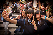 Japanese school girls take 'selfie' of group with cell phone, Kyoto, Japan