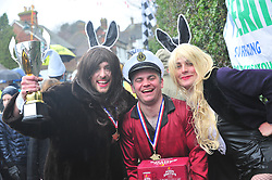 &copy; Licensed to London News Pictures.01/01/2018<br /> SUTTON VALENCE, UK.<br /> PLAYBOY TEAMING WIN. LTR JOSH DAVIES,JAMES BADWICK,FRED Mc VARISH.<br /> The traditional New Years day Sutton Valence Pram Race in Kent continued this year. In its 38th year the Race was struck by tragedy last year when competitor Francis 'Titch' O' Sullivan tipped over in his spitfire pram and hit his head on the curb, he passed away a day later. A coroners court reported he was not wearing a helmet.<br />  All babies in the pram's have to wear a helmet and the pushers must have contact with the pram and the ground at all times.<br />  <br /> Photo credit: Grant Falvey/LNP