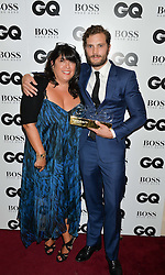 E L JAMES and JAMIE DORNAN winner of the Vertu Breakthrough Award at the GQ Men Of The Year 2014 Awards in association with Hugo Boss held at The Royal Opera House, London on 2nd September 2014.