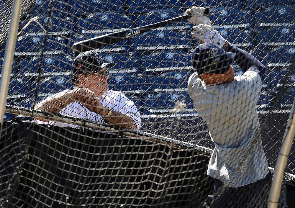 Pete Rose, left, watches batting practice at The Ballpark at Harbor Yard, Monday, June 16, 2014, in Bridgeport, Conn. Rose, banned from Major League Baseball, returned to the dugout for one day to manage the independent minor-league Bridgeport Bluefish. (AP Photo/Jessica Hill)