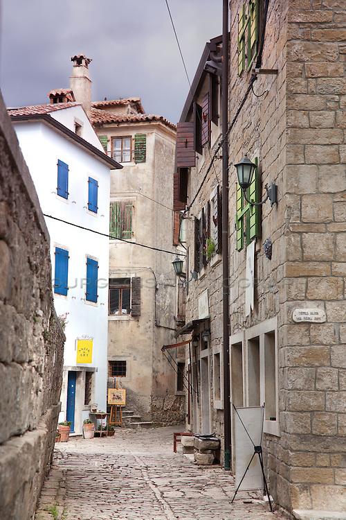 Small alleyway in Groznjan Croatia full of old buildings
