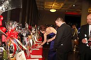 Silent auction bidders and potential bidders look at items during the 18th annual Heart Ball, ?Ignite the Magic? at Sinclair Community College's David H. Ponitz Center in downtown Dayton, Saturday, March 23, 2013.