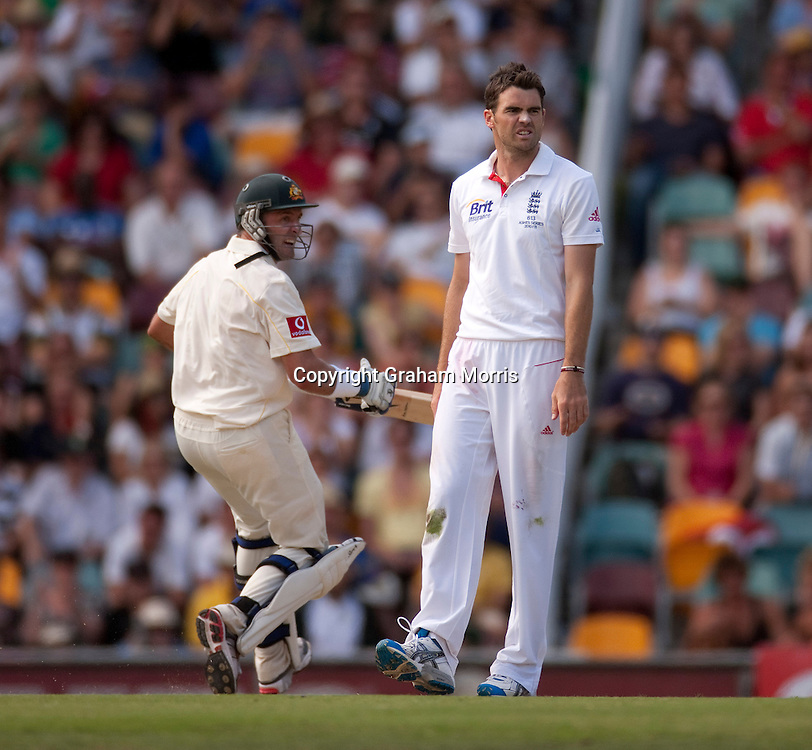Luckless bowler James Anderson watches as century-maker Michael Hussey (left) hits him for four during the first Ashes Test Match between Australia and England at the Gabba, Brisbane. Photo: Graham Morris (Tel: +44(0)20 8969 4192 Email: sales@cricketpix.com) 27/11/10